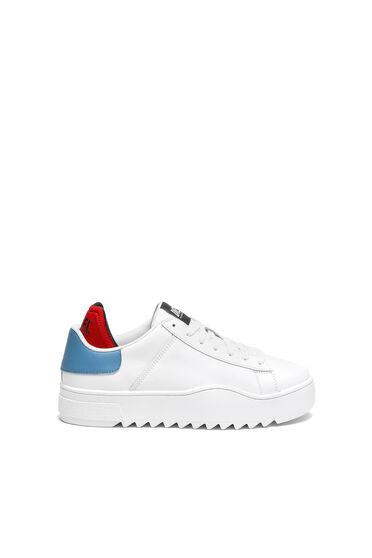 Sneaker in pelle con finiture a contrasto