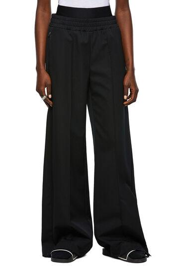 Pantaloni a tessitura compatta con spacchi laterali